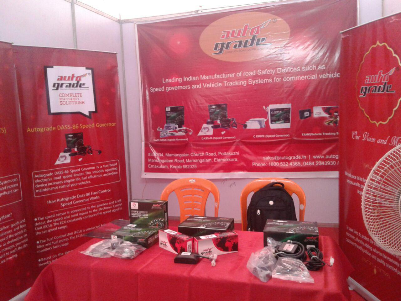 Autograde's stall displaying speed governors at a road safety event in Thiruvananthapuram.